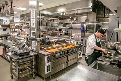 The importance of adequate mise en place for each station and proper aisle width to optimize chefs' efficiency is seen in Ricca Design Studio's design of the kitchen at Hotel Indigo in Atlanta. Photo courtesy of Ricca Design Studio