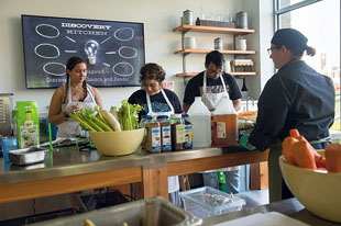 Sarah Langan, UVM Dining's executive chef of Culinary Education, teaches students how to cook at Discovery Kitchen.
