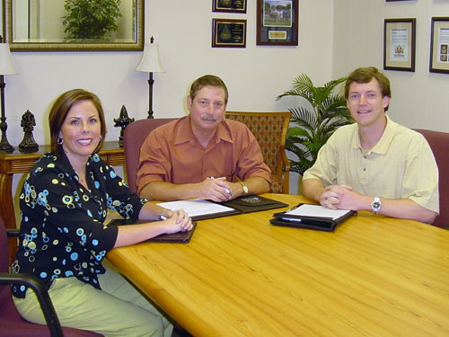 (From left): Maribeth Wolfe Angelo, sales manager of the dealership's Jackson branch; Mike Williamson, general manager of the Jackson branch; and Mason Greene, Hotel & Restaurant Supply Operations, review some client information.