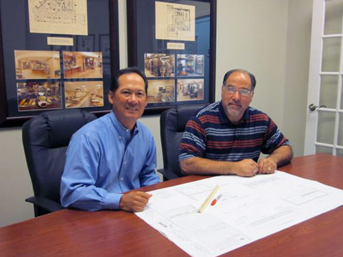 Jim Moran (left), general manager of Hotel & Restaurant Supply's Memphis branch, and Paul Levine, the branch's sales manager, review the drawings for a client project.