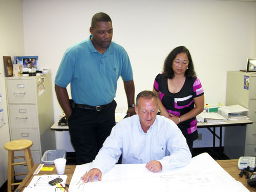 (From left) Billy Gooch, operation manager for Hotel & Restaurant Supply's Nashville, branch; Phil Pendley, the branch's general manager; and Lin Lee, contract administrator, review a job together.