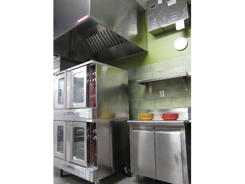 Staff use the convection ovens near B&#39;s Bistro to heat entrees and cook bacon, biscuits and sausage.