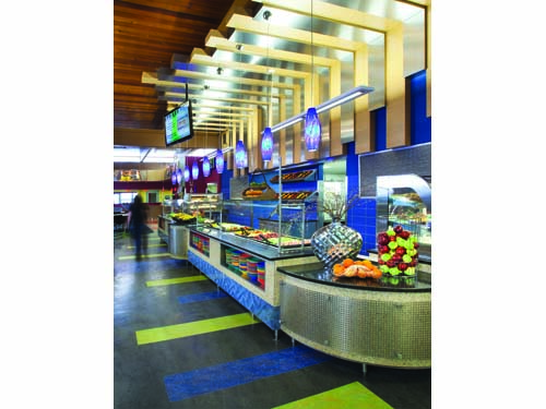 The salad bar's pre-made and make-your-own salads are customer favorites. The use of natural wooden beams that resemble inverted piano keys draws attention to this station.