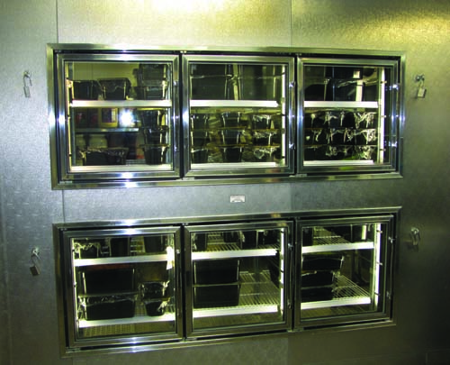 Refrigerators in the salad station contain reach-in glass doors that allow staff to replenish as needed and save steps.