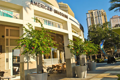 Cassis American Brasserie's location is ideal to attract customer traffic. It sits on the ground floor of a high-rise condominium surrounded by many neighboring condos and is across the street from a waterfront park and marina. The sculpture shown at right is made of stainless steel and prism glass.