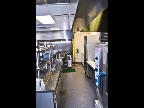 All the equipment is modulated in this kitchen so there are no seams or gaps. All equipment sits on wheels for sanitation and flexibility of movement. The curbs are built into the floor; and the utilities are built into the curbs, which are built into the counters.