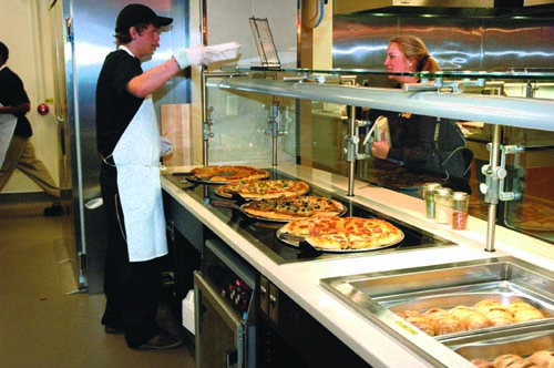 The back of the pizza station contains a hot holding counter and pans, which allows for relatively short waiting times.
