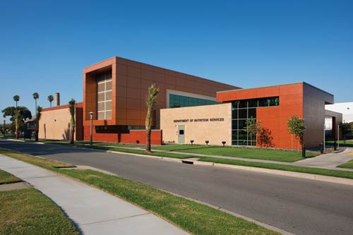 The Department of Nutrition Services LEED gold-certified building&#39;s exterior uses Forest Stewardship Council-certified wood panels and solar tubes to enhance spaces that were limited from receiving natural daylight.