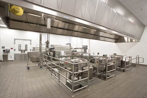 The cook-chill liquid-cooking pumpable system is recessed into a 30-inch-deep pit for ease of loading kettles. Menu ingredients are placed in baskets and lowered into one 100-gallon and two 150-gallon tilting kettles.
