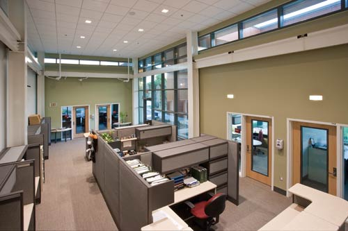 Natural light streams into office spaces, which reduces the consumption of artificial light.