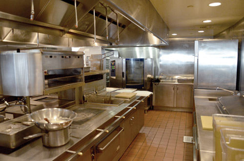 Appetizer production takes place on this side of the suite with the fryers, grill and salamander.