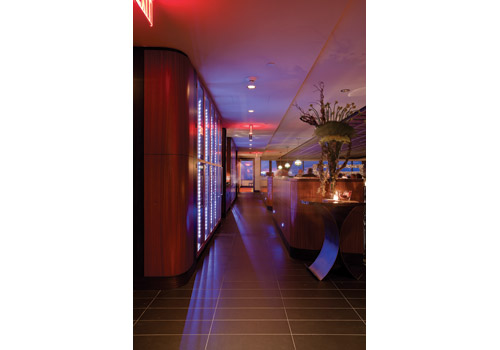 Outside light streams into all parts of the restaurant. The wine wall runs the length of the restaurant.