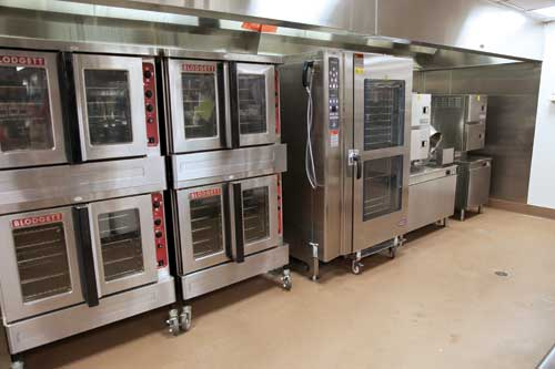 Staff use combi ovens and convection ovens for preparation of meats, poultry and myriad menu items.
