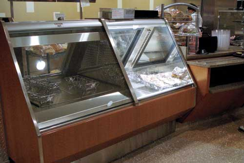 A display merchandiser at the grab-and-go station allows customers to see the food items they would like to take out.<span>