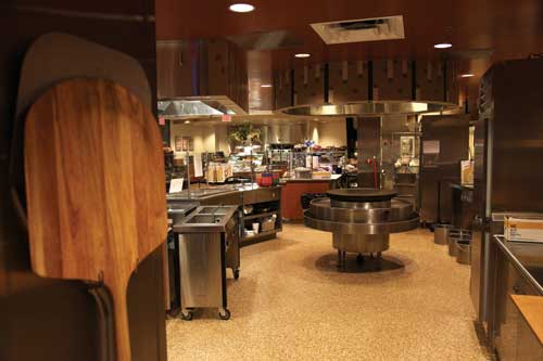 At Creations station, a Mongolian grill provides eatertainment. The hood design contributes to the overall interior design and becomes a key showpiece in the servery.