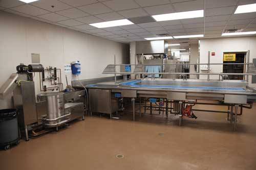 In the dishroom, a pulper pulverizes all the excess food and removes excess water, thereby cutting down on the volume of trash. The water used for transferring the waste to the pulper via the trough recirculates so that new water is not wasted.