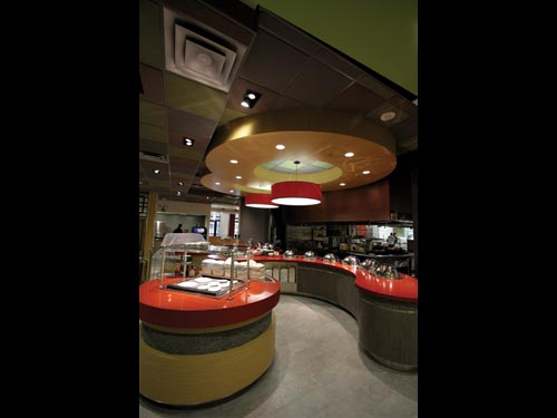 Staff use woks to prepare many of the Asian menu choices, which are presented in contemporary arrangements at the serving counters.