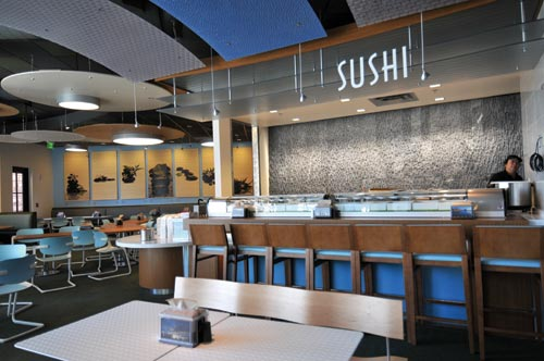 Customers can opt to sit in the sushi seating area (here and below) with its light blue aquatic color scheme and water wall.