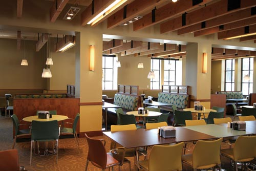 One of the dining rooms, Colorado Room, provides a variety of seating options. The ceiling beams' natural colors and placement create a comfortable ambiance for dining.