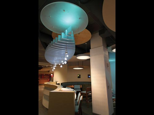 Customers can opt to sit in the sushi seating area with its light blue aquatic color scheme and water wall.