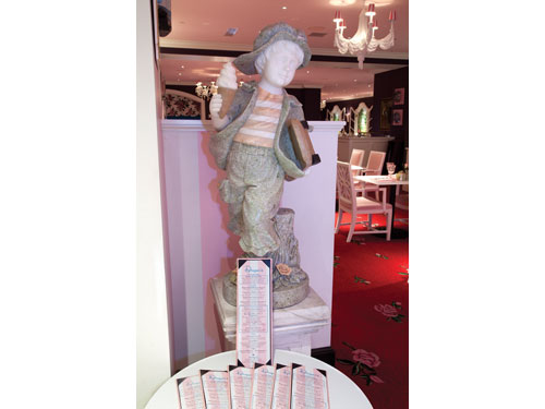 A statue of a boy welcomes guests into Draper's.