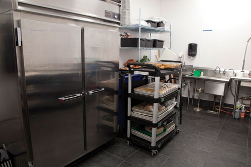 Refrigerator and carts in Café Carleton's Kitchen.