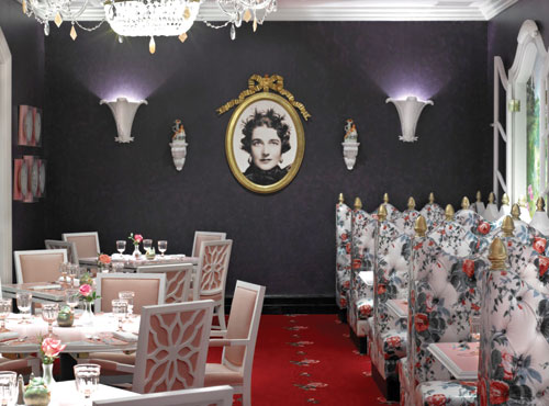 Dorothy Draper's portrait hangs in the restaurant as a tribute to her interior design, which she brought to the Greenbrier decades ago and which is replicated in the new Draper's designed by Carleton Varney.