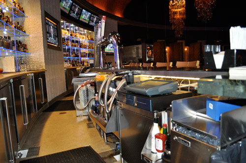 The Sky Box bar's liquor, beer and soda system is connected to the dispensing rooms in the back of the house kitchen. A central dispensing system allows all service to be handled sight unseen. All of the underbar equipment is suspended so there is no clutter or waste collecting under the bar, which also prevents odors.