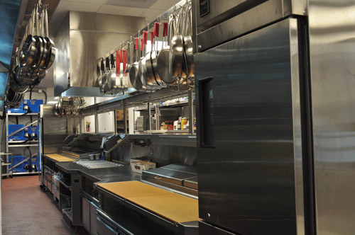 The chef's counter (below), has two refrigerated rails containing refrigerated drawers that hold salad mixes, sliced meats and other ingredients. On the top deck sit condiments, relishes, dressings and garnishes. The rails are fit with suspended lids.