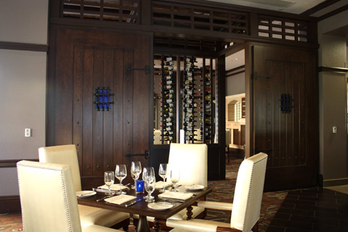 The private dining area at deep blu contains a door similar to one that might have been found on a Spanish ship.