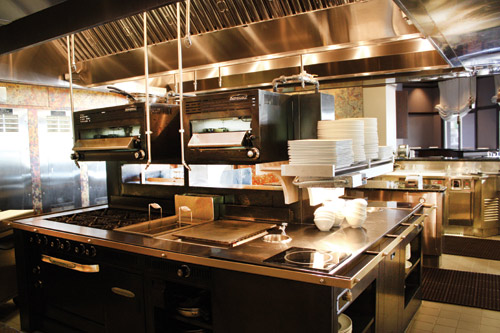 At deep blus island suite, a plancha (in the center of the cook counter) is a key feature. The design consultant put extra incandescent lights in the hood to give the space a brighter glow and better visibility for chefs.