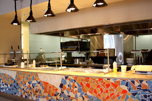 Left: In Tesoro Cove, colorful tiles add to the bright décor. A cooking island behind features a pizza oven that is accessible from the front and back.