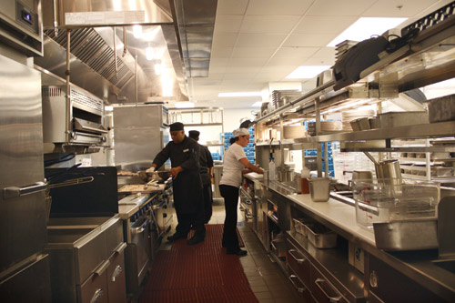 In the main kitchen, flexibility and sanitation were key considerations. All the equipment is off the floor on casters. A raceway allows gas and electric connectivity. Sightlines are open so everyone can be seen from all parts of the kitchen. Double shelving enhances productivity, efficiency and sanitation by giving every smallware item a specific storage space.