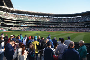 The 'Pen patio at Safeco Field allows fans to watch the game while ordering and eating food.