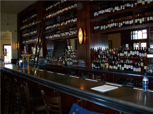 The bar features mahogany wood millwork, Italian draft heads and a zinc bar top.