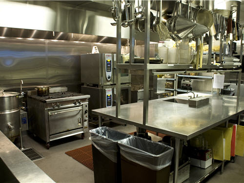 A center worktable allows staff to use the surface space fully while moving around the kitchen. The kettle, range, combi oven and fryers are sufficient for back-of-house production to allow chefs in the front of the house to keep up with customer demand.