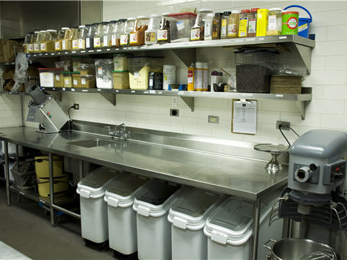 Every ingredient bin, spice and container has its distinct position in the kitchen, thereby making use of every available square inch. Raised counters allow easy cleaning. The restaurant subjects itself to strict internal sanitation reviews.