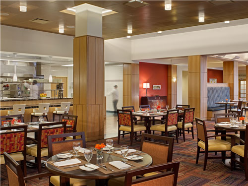 An informal dining room in Centro allows   guests to view the action in the display kitchen. Natural materials and a   soft color palette provide a comfortable dining environment that doesn't   seem old when guests come here day after day.