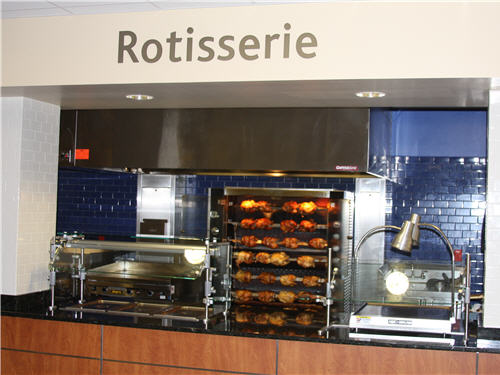A rotisserie with eight spits handles peak traffic periods. Chickens are popular for home-meal replacement.