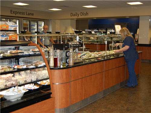 A salad bar contains 14 feet of cold wells, unobtrusive dispensers and a refrigerated display case for to-go options.