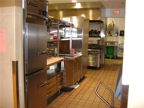 At the cold prep station, an upright refrigerator holds ingredients. The three sections are removed and placed in the dishwasher. Refrigerated drawers sit beneath the cutting board.