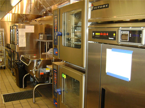 On the hot line, a double-stacked combi oven, a tilting skillet, landing tables, a double-stacked convection oven with a bakery mode and two six-burner ranges with ovens and a cheese melter above can be used for regular restaurant service and for banquets and catering.