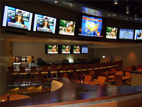 The Las Vegas-style Highlight Zone features plasma-screen TVs and an expansive, semi-circle-shaped bar, all of which adds to the entertaining ambience.