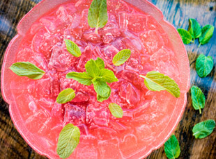 The shared cocktail trend takes form as a watermelon punch drink at Punch Bowl Social. Photo Courtesy of Punch Bowl Social