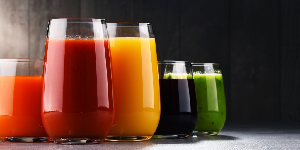 glasses with fresh organic vegetable and fruit juices picture id862626022
