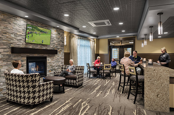 Onsite pub and apts int clubhouse bar w people